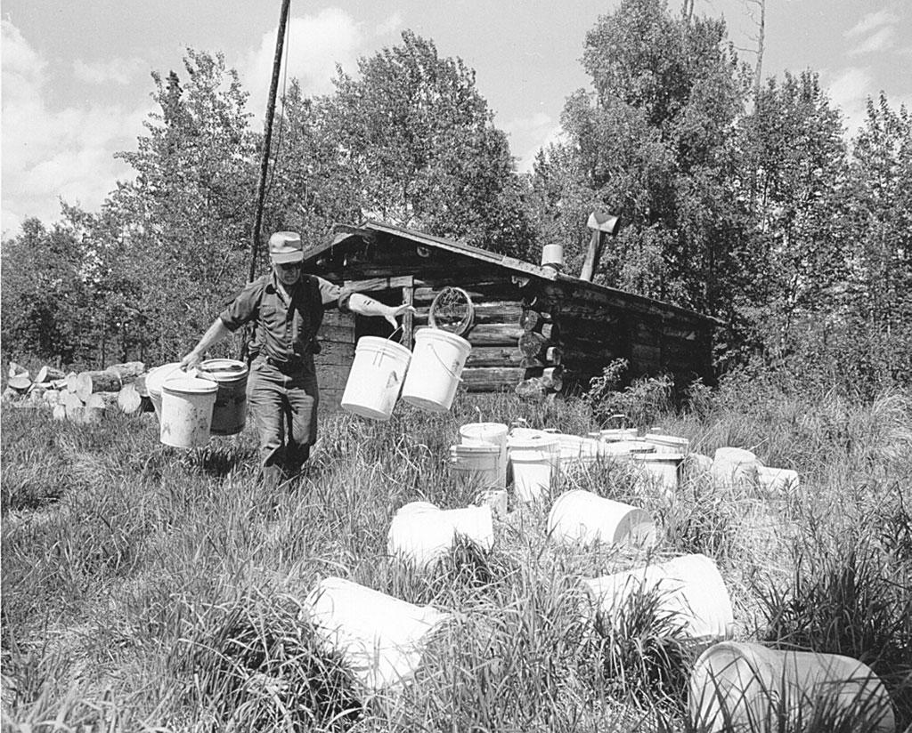 Gene Walters with bait pails at Meekwap Lake