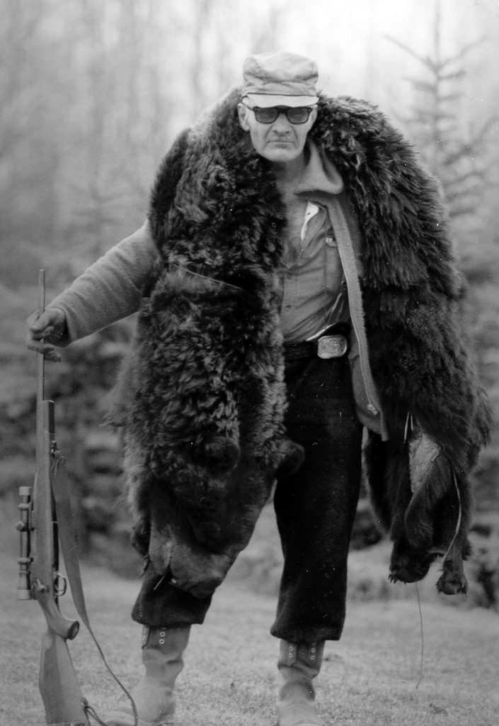 Gene Walters packing grizzly hide